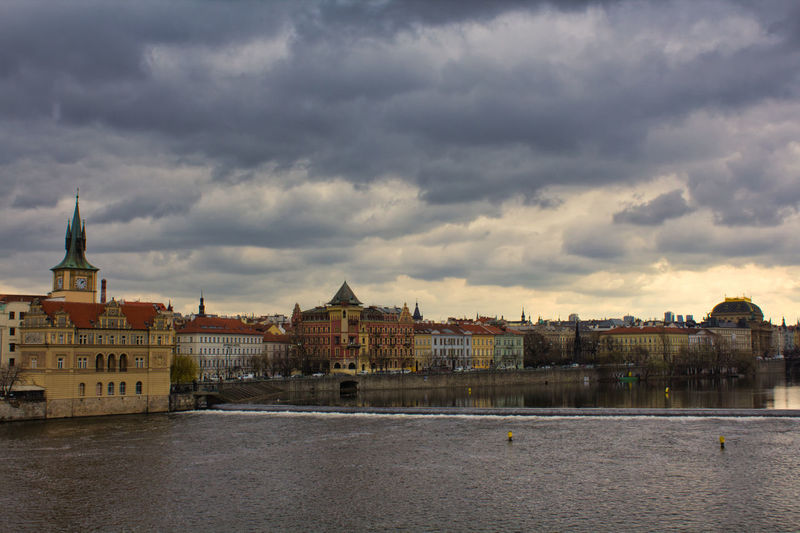 Cloud - Sky Architecture Building Exterior Built Structure Sky Water Building City Nature Waterfront No People Overcast River Residential District Storm Outdoors Dusk Day Cityscape Streetphotography Street Photography Street Prague
