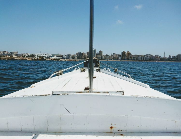 To the north.. Sea Beach Water Morning Sky Sea And Sky Sea View Alexandria Egypt No People EyeEmNewHere EyeEm Best Shots Eyeemphotography Boat Sail Sailing Front View Outdoors Travel Traveling Blue Waves Blue Sky Eyeem Travel White White Boat