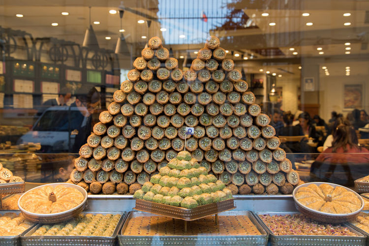 Baklava Sweet Food Sweet Turkish Food And Drink Food Incidental People Large Group Of Objects Freshness For Sale Retail  Focus On Foreground Abundance Market Indoors  Business Market Stall Store Arrangement Wellbeing Illuminated Retail Display Healthy Eating Choice Sale