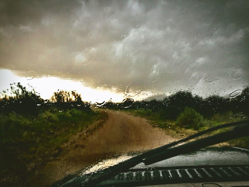 """""""Wrong Day To Drive"""" Caught in a big thunderstorm on a rural road in The Central Highlands of New Mexico. Rain Rainy Days Raindrops Thunderstorm Monsoonseason Windshield Windshield Wipers Downpour Newmexicophotography Newmexico"""