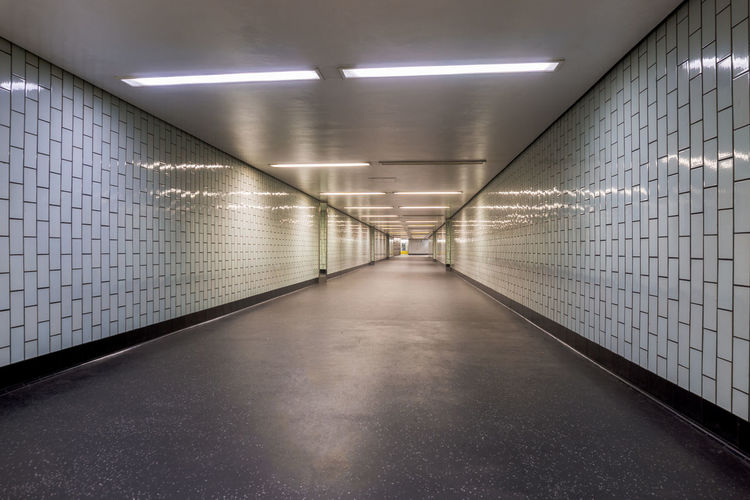 Diminishing Perspective Of Illuminated Underground Walkway