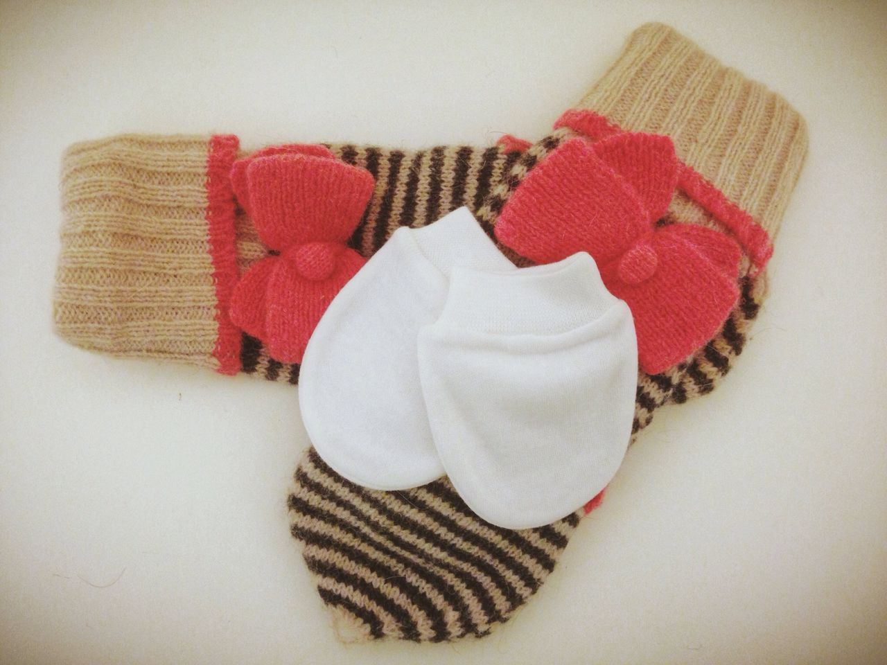 Close-up of socks over white background