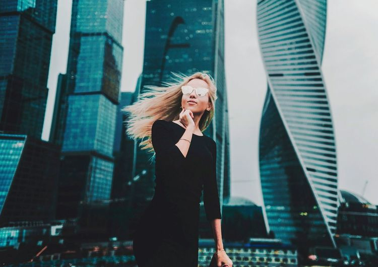 EyeEm Selects Only Women One Person People Business Blond Hair Casual Clothing City Life Communication Women One Woman Only City Mature Adult Adult Adults Only Skyscraper Businesswoman Business Finance And Industry Well-dressed Outdoors Standing