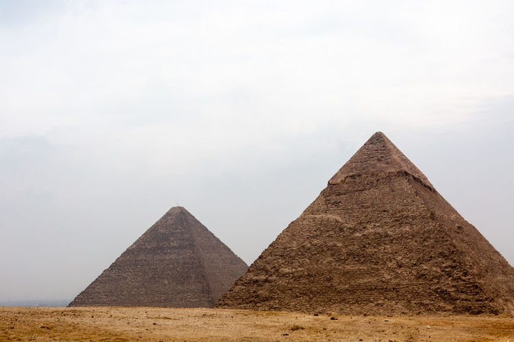 Pyramid Architecture Ancient Ancient Civilization History The Past Sky Travel Destinations Triangle Shape Built Structure Desert Travel No People Tourism Nature Building Exterior Shape City Day Outdoors Climate Arid Climate Ancient History Archaeology