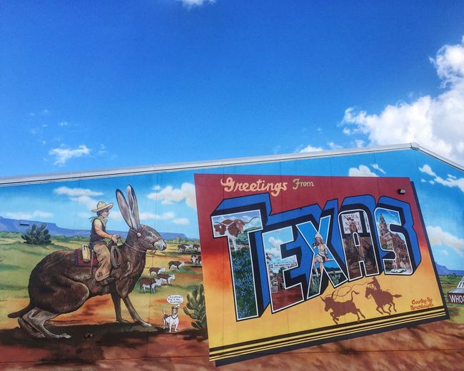 From Texas, y'all Sky Blue Sky Clouds Postcard Greetings Texas Building Jackrabbit Everything's Bigger In Texas !