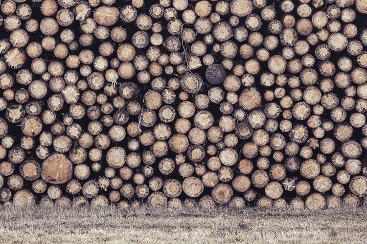 Full frame shot of logs on field