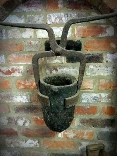 Old smelting pot hung on an old brick wall. No People Metal Full Frame Indoors  Close-up Backgrounds Day Smelting Old Old Buildings Rusted Metal  Cast Metal Ironmongery Ironmonger
