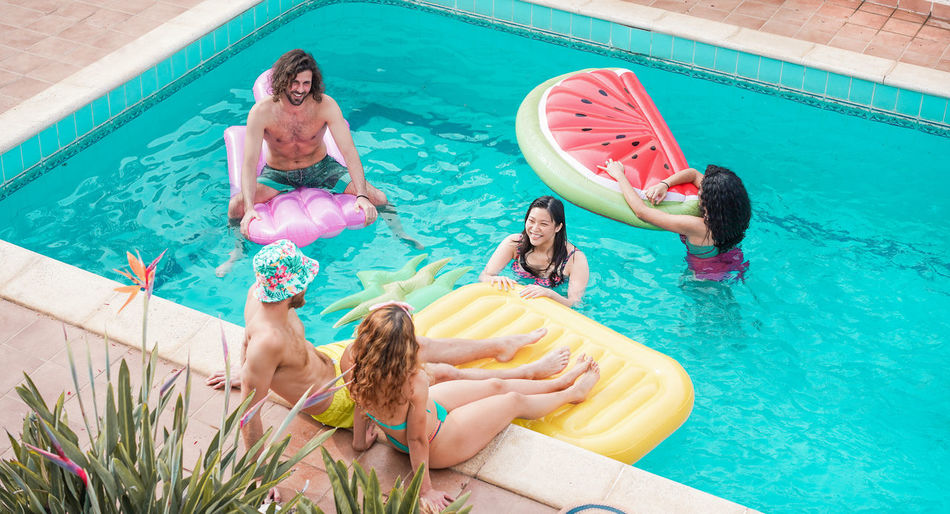 Happy friends floating with air lilo ball at swimming pool party - Young people having fun on summer holidays vacation - Travel, friendship, youth and tropical concept - Focus on asian girl face Millennials Millenials Young People Friends Party Water Pool Group Of People Swimming Pool Women Leisure Activity Swimwear Lifestyles Holiday Men Vacations Inflatable  Floating On Water Girls
