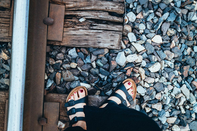 rail tracks with my birks Body Part Day Gravel Human Body Part Human Foot Human Leg Human Limb Lifestyles Log Low Section Nature One Person Outdoors Pebble Personal Perspective Real People Rock Shoe Solid Standing Stone - Object Timber Track Wood Wood - Material