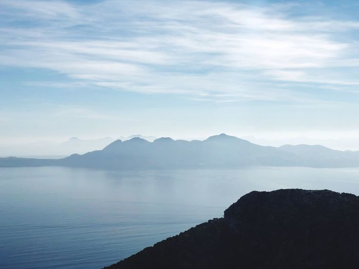 Isle Sky Scenics - Nature Water Beauty In Nature Tranquility Cloud - Sky Mountain Tranquil Scene Nature Non-urban Scene Sea Idyllic Day Land Outdoors Mountain Range No People Silhouette