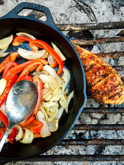 Vegetables In Pan With Chicken Meat On Barbeque Grill