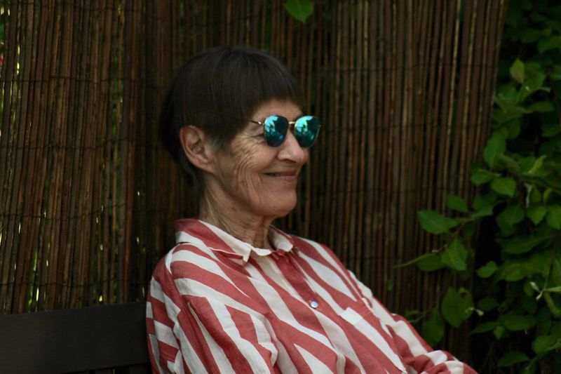 Hiding from the sun Grandma Adult Headshot One Person Portrait Women Mature Adult The Portraitist - 2018 EyeEm Awards Lifestyles Smiling Glasses Females Casual Clothing Mature Women Nature Leisure Activity Plant Senior Women Relaxation Looking Hairstyle Human Face