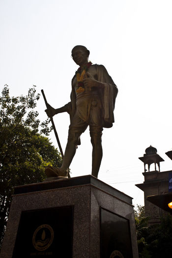 Low angle view of man statue against clear sky