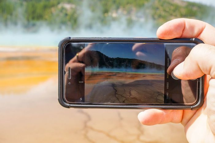 Taking photo Real People Smart Phone Wireless Technology Mobile Phone Cellphone Device Screen Taking Photos Grand Prismatic Spring Yellowstone National Park Using Phone IPhone