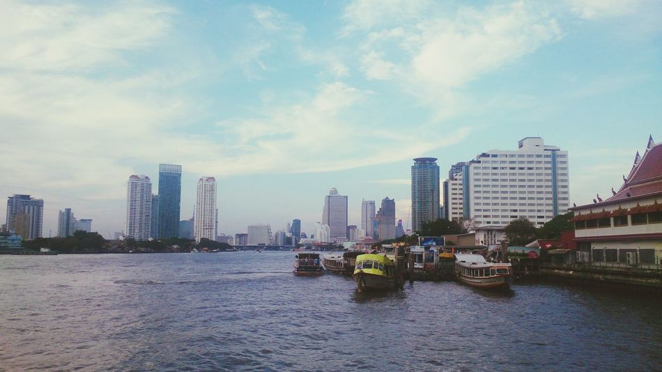 Urban Skyline City Skyscraper Modern Building Exterior Cityscape Architecture Travel Destinations Outdoors Sky Cloud - Sky No People Water Day Downtown District Pier Bridge - Man Made Structure Ferry Bangkok Thailand