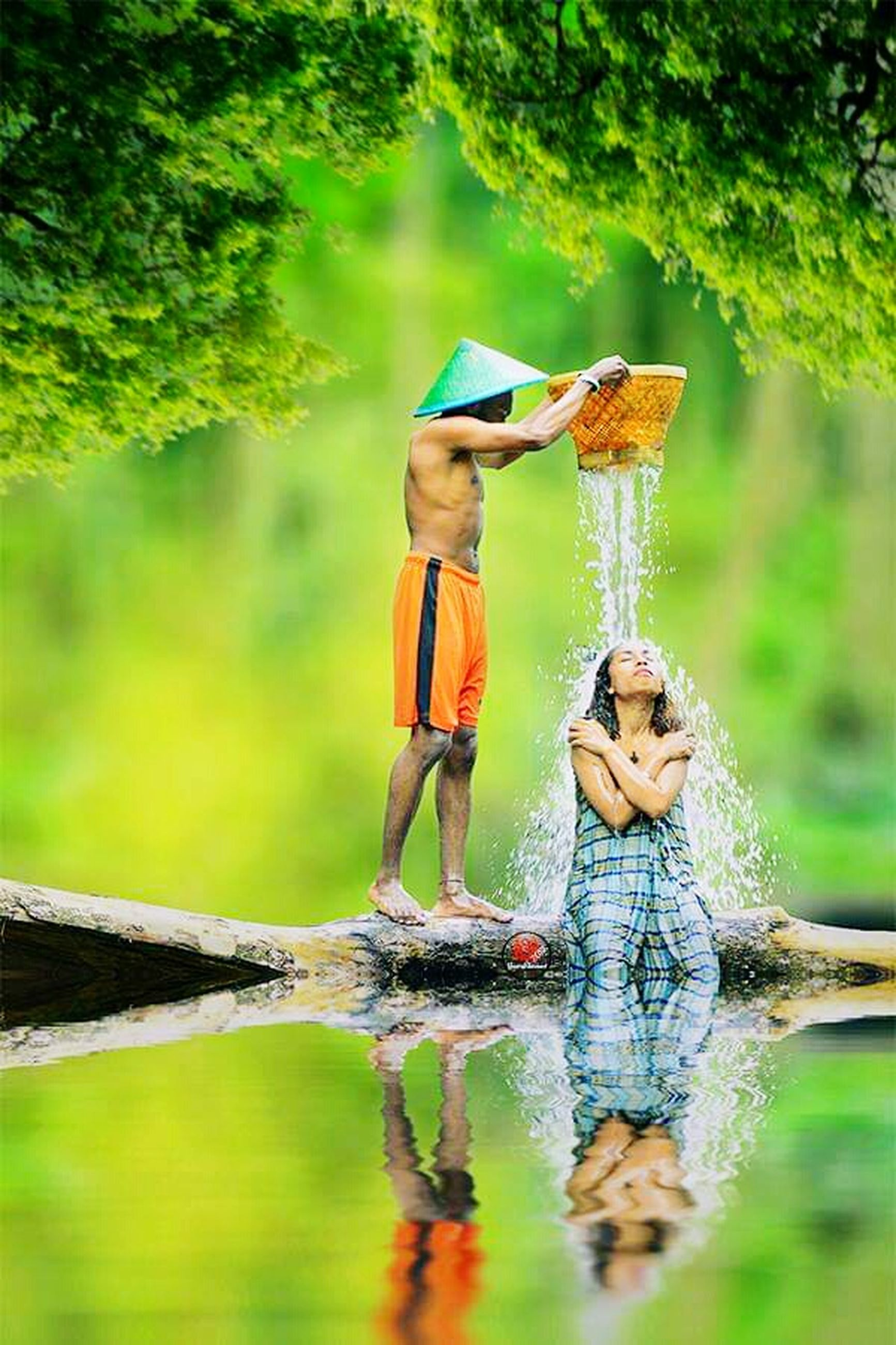water, child, childhood, nature, tree, offspring, men, males, wet, people, forest, summer, boys, togetherness, beauty in nature, playing, green color, holding, outdoors, small, positive emotion