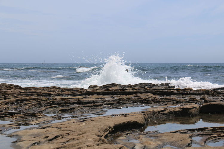 Beauty In Nature Blue Day Horizon Over Water Idyllic Majestic Motion Nature No People Non-urban Scene Outdoors Power In Nature Remote Rock - Object Scenics Sea Shore Sky Splashing Tranquil Scene Tranquility Water Wave