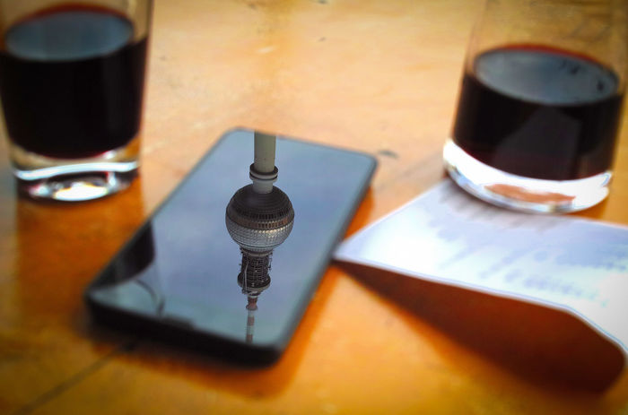 Beverage Focus On Foreground Mobile Phone Reflection Still Life Table Tvtower Berlin Alexanderplatz [a:826298] Wine Capture Berlin