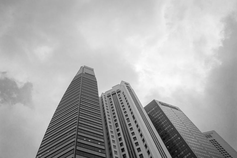 Clouds over Buildings of Banks in Raffles Place, Singapore. In black and white. Architecture Attractions Attractions Butterfly Background Banks Black And White Buildings Clouds Cloudy Conditions Financial Center Financial District  Landmarks Modern Raffles Pla Singapore Singapore View Situation Travel Weather