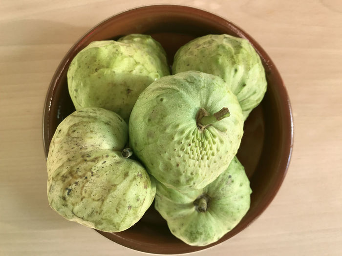 Bowl of chirimoya, custard apple, fruit Bowl Chirimoya Close-up Custard Apple Day Food Food And Drink Freshness Fruit Green Color Healthy Eating No People Table