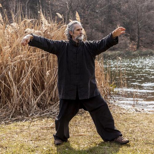 Full length of man standing on field