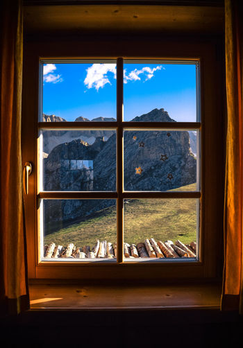 EyeEm Selects Window Glass - Material Looking Through Window Sky Frame Indoors  Window Sill Cityscape Mountain No People Architecture Day Scenics Travel Destinations City Tree Through The Window High Angle View Tranquility Freshness Tourism Travel Nikond3300 Light And Shadow The Week On EyeEm