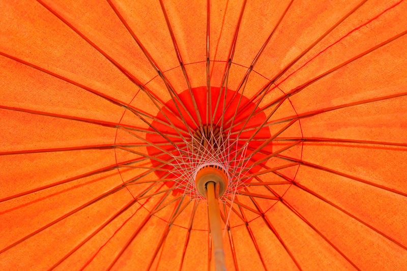Low angle view of red umbrella