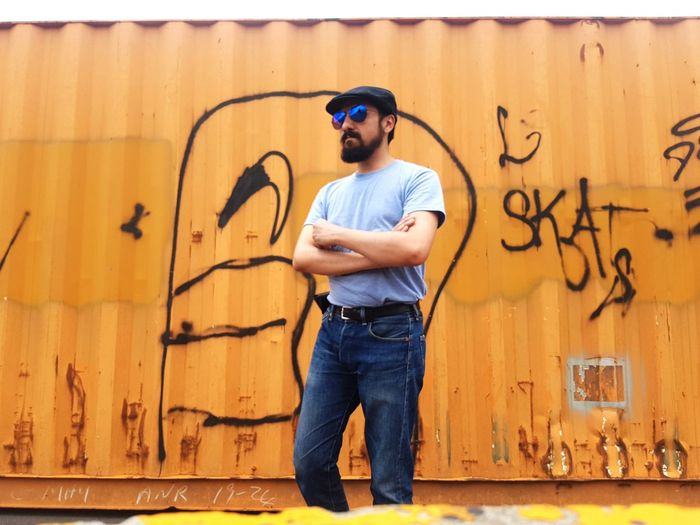 Man Wearing Sunglasses While Standing Against Graffiti Wall