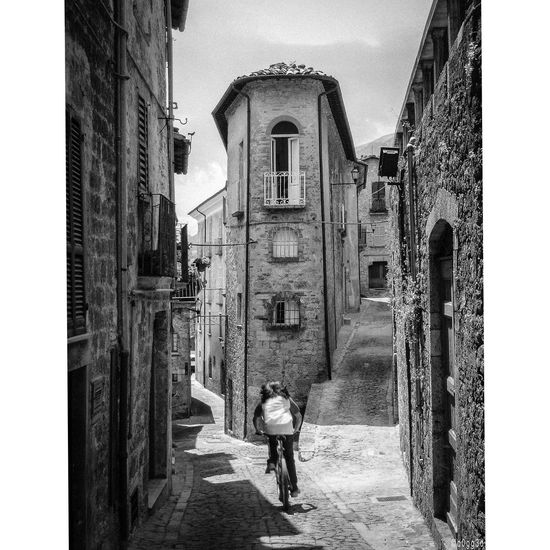 Abruzzo Alley Alleys Ancient Civilization Architecture Building Built Structure Cobblestone Culture Cycling Fork In The Road Historic House Italy Motion Narrow Residential Structure The Decisive Moment The Way Forward à La Sauvette