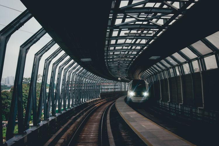 Train Moving On Railroad Bridge In City