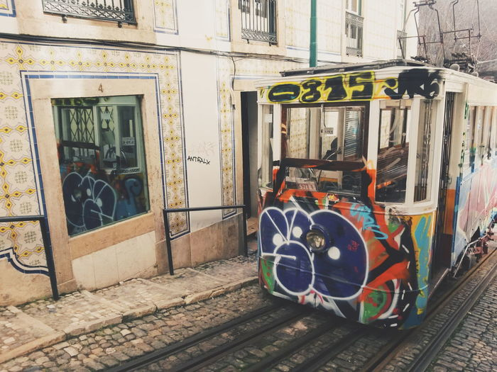 Portugal Tram Architecture Building Exterior Built Structure City Communication Day Graffiti Lisbon Mode Of Transportation Old Public Transportation Rail Transportation Railroad Track Street Track Train Transportation
