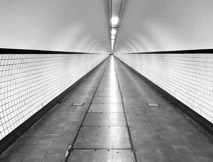 Antwerpen Blackandwhite Direction The Way Forward Architecture Built Structure Footpath Illuminated Lighting Equipment Empty Transportation No People Diminishing Perspective Flooring Subway Indoors  Wall - Building Feature Light Tunnel Wall Ceiling Tile EyeEmNewHere