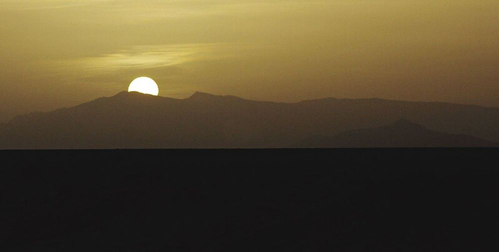 desert sunset Morocco . Tranquil Scene Scenics Mountain Silhouette Sunset Sun Beauty In Nature Tranquility Non-urban Scene Solitude No People Outdoors Landscape Photography Mountain Range Landscape #Nature #photography Landscape_photography Mountain Peak Morocco Sunset Silhouettes