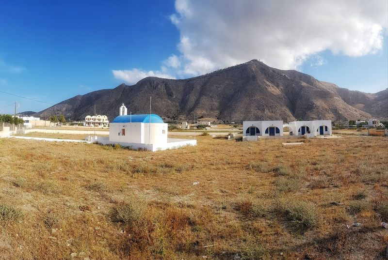 some of the scenery in the beautiful Perissa Malephotographerofthemonth Landscape_photography Creative Light And Shadow Color Photography Scenic Landscapes Perissa Santorini Island Mountain Agriculture Rural Scene Sky Landscape Built Structure Architecture Building Exterior
