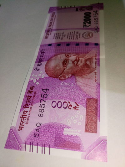 Indian two thousand rupee note 2000 Banknote Business Close-up Currency Indian Finance Finance And Economy Indian Culture  Indian Currency Indian Two Thousand Rupee Note Indoors  New No People Paper Currency Pink Color Savings Success Text Two Thousand Rupee Note Wealth