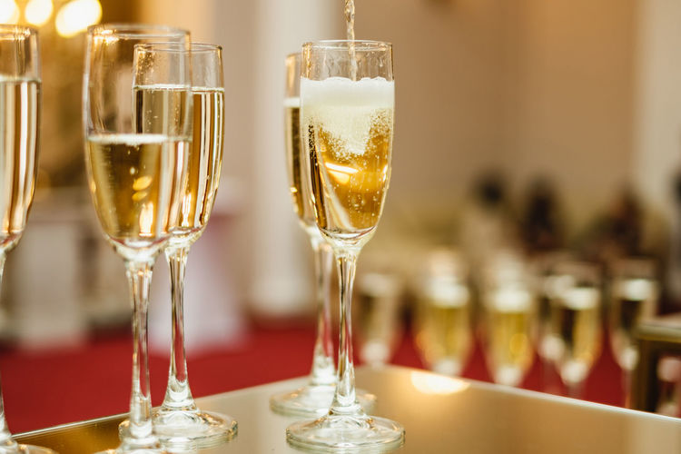 Glasses with prosecco. Luxury drink background Glass Prosseco Restaurant Champagne Focus On Foreground Drinking Glass Alcohol Household Equipment Refreshment Food And Drink Drink Glass - Material Wineglass Champagne Flute Freshness No People Luxury Business Wine Indoors  Transparent Table