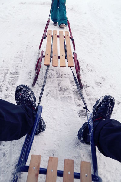 Adult Close-up Cold Temperature Day Human Body Part Human Leg Leisure Activity Low Section Nature One Person Outdoors People Real People Sled Sledge Sleigh Snow Vacations Winter Winter Sport