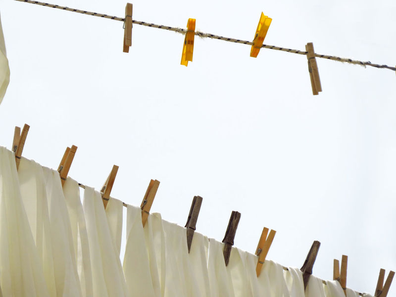 Abundance Arrangement Close-up Clothes Clothesline Clothespin Clothespins Drying Drying Clothes Focus On Foreground In A Row Large Group Of Objects Laundry Linen Lines Low Angle View Peg Pins Repetition Sheets Side By Side String Strings Washing White Linen
