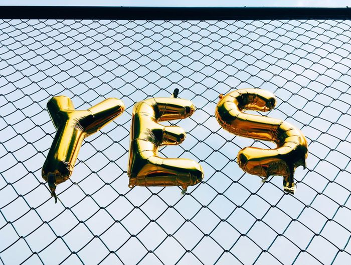 Balloon Yes No People Pattern Day Flooring Metal Tile Fence Low Angle View Chainlink Fence