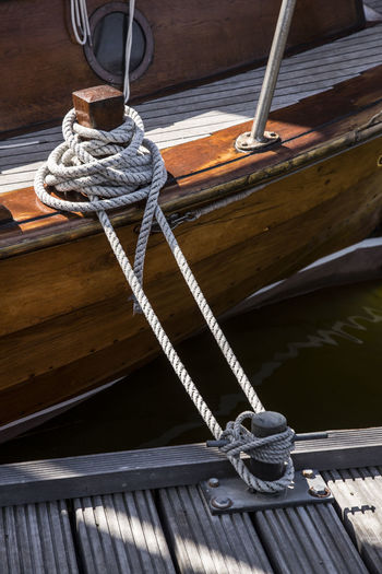 High angle view of sailboat tied to boat