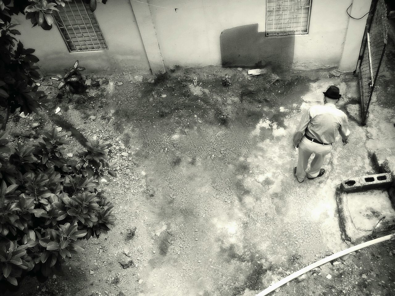 High Angle View Of Man Standing In Alley