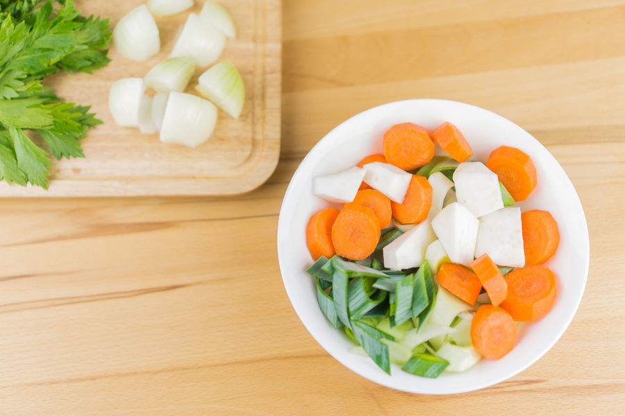 Garlic Herbs Leek Bowl Carrots Celery Close-up Cutting Board Day Food Food And Drink Freshness Healthy Eating High Angle View Indoors  Mirepoix No People Onions Plate Ready-to-eat Sliced Table Vegetable Wooden Background