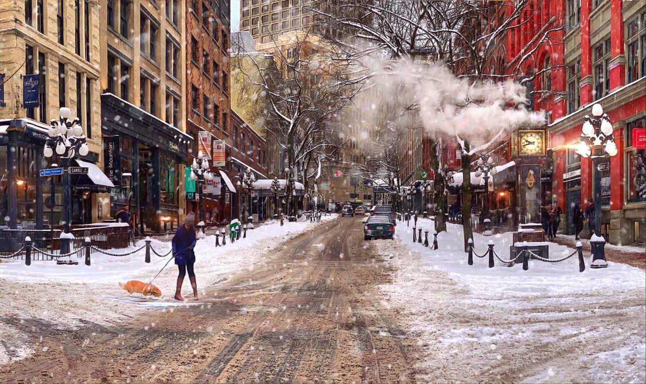 PEOPLE ON CITY STREET BY SNOW DURING WINTER