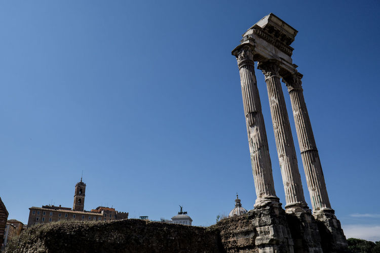Low angle view of roman forum against clear sky
