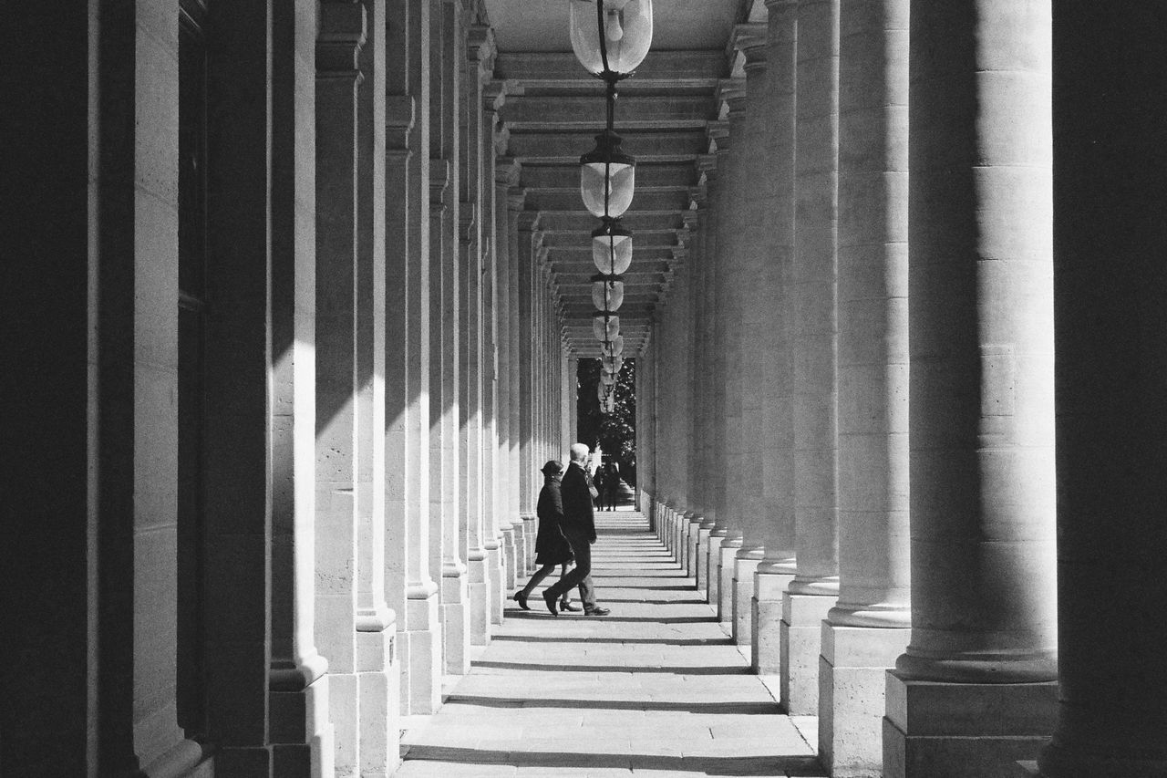 real people, in a row, walking, architectural column, architecture, built structure, full length, men, indoors, the way forward, day, lifestyles, two people, women, illuminated, people