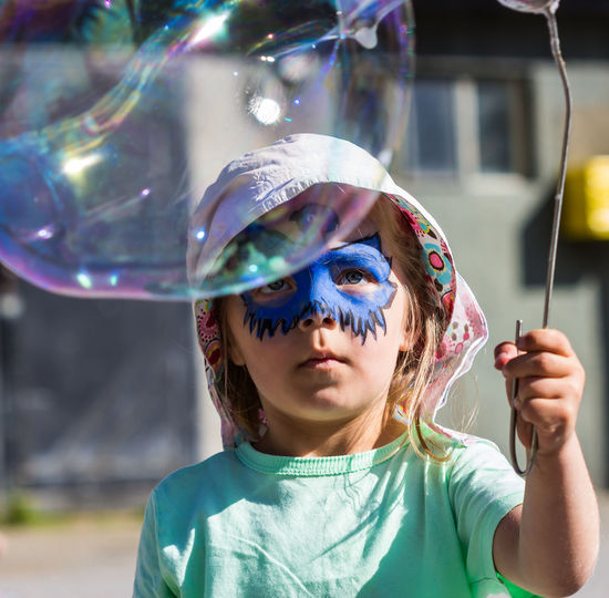 Concentration Bubble Childhood Children Concentration Enjoyment Face Painting Girl Leisure Activity Outdoors Soap Bubble Sunny Day