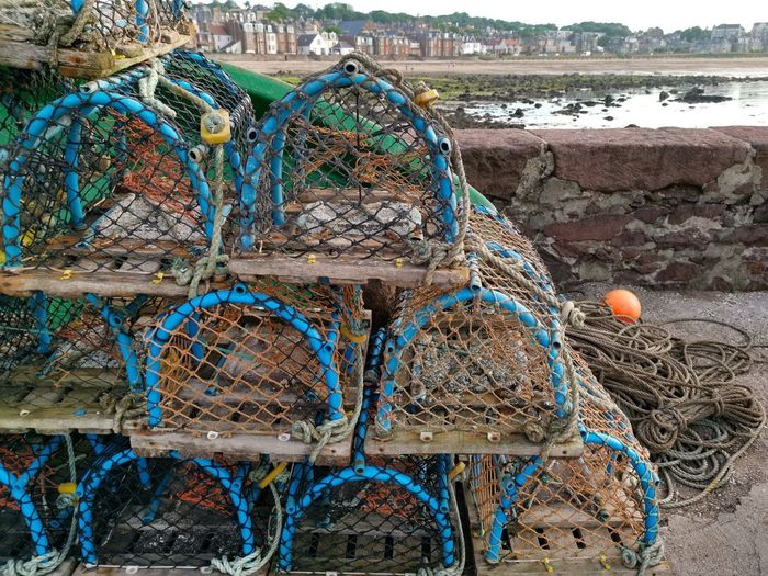 Stack of fishing net at harbor