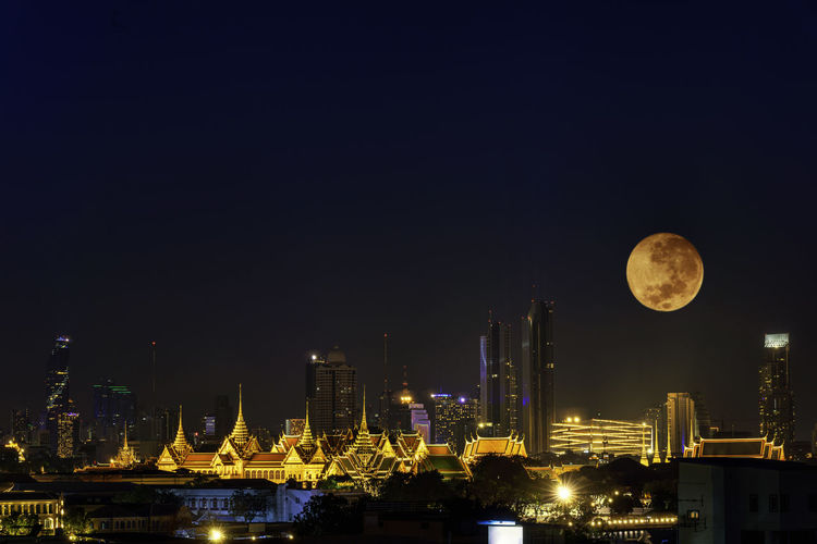 Cityscape of night view with super moon. night view in the business location. bangkok, thailand