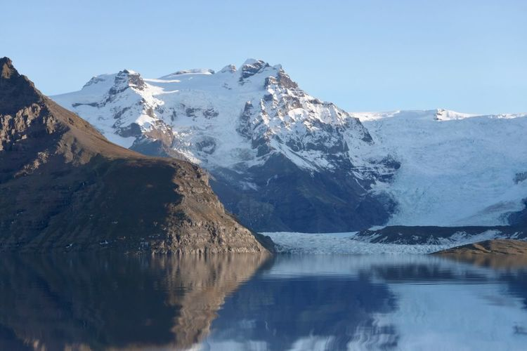 Beautiful scenery mountain in iceland with smooth reflection and snow on the mountains.