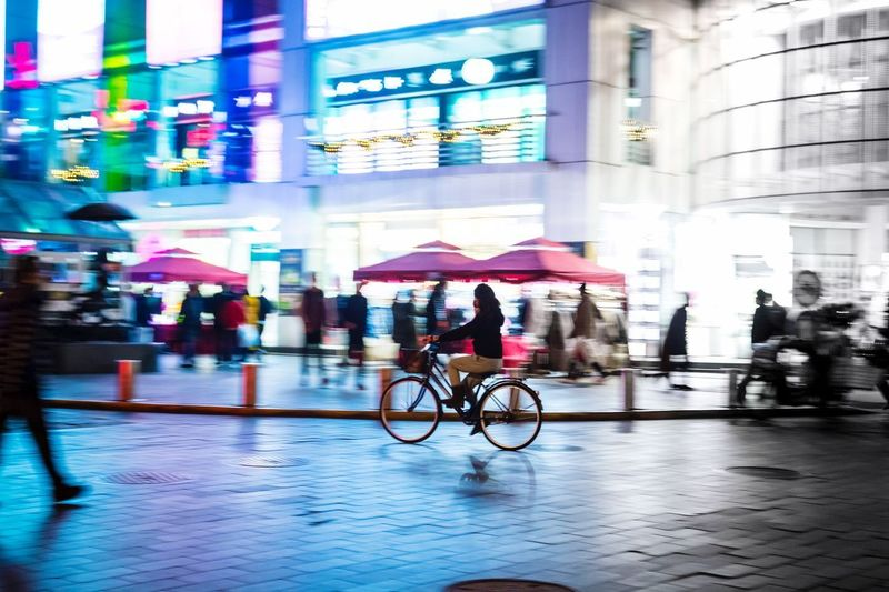 The Street Photographer - 2017 EyeEm Awards Real People China Shanghai Bicycle Neon Motion